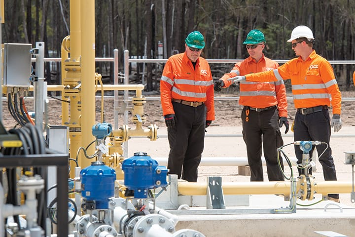 Chris Finlayson (left) and Mitch Ingram (centre) at a gas well in the Surat Basin.